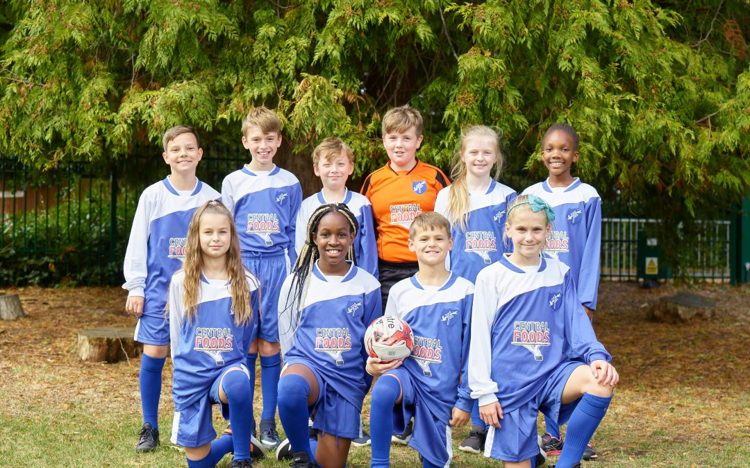 Pupils receive new football kit, thanks to Central Foods
